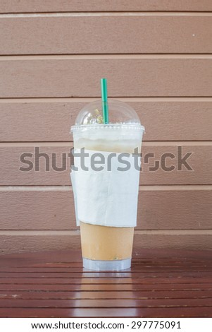 Ice Coffee on Wooden Backgrounds - stock photo