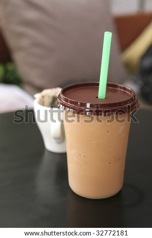 ice coffee with cappuccino on black table - stock photo