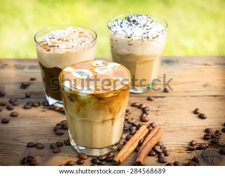 Ice coffee with milk and whipped cream  - stock photo