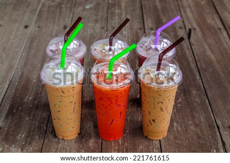 Ice coffee wooden background - stock photo
