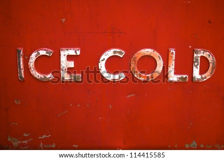 Ice Cold: detail of red antique beverage cooler - stock photo