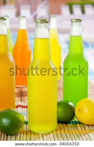 Ice cold drinks on the table around the pool - stock photo