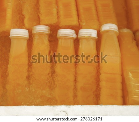 Ice Cold Orange Juice Bottle - stock photo