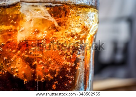Ice cold soft drink with bubbles evolving upwards. - stock photo