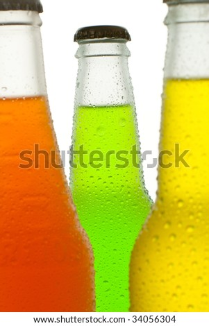 Ice cold tropical drinks in wet bottles - stock photo