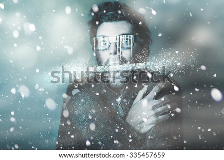 Ice cold winter art of a man holding explosive thermometer in shivering jaw while in a freeze of snow and frost from a blizzard of falling white ice. Temperature below freezing - stock photo