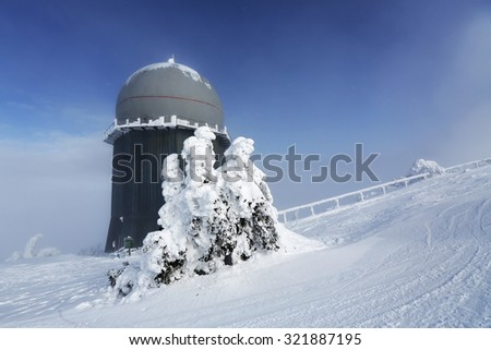 Ice-covered screen weather station, high on mountain-top, Germany - stock photo