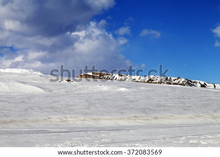Ice-covered slope in sun day. Greater Caucasus, Shahdagh. Qusar rayon of Azerbaijan. - stock photo
