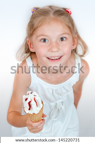 Ice Cream cone. Little girl with ice cream  in studio isolated - stock photo