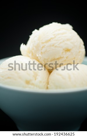 Ice Cream cup isolated over black background