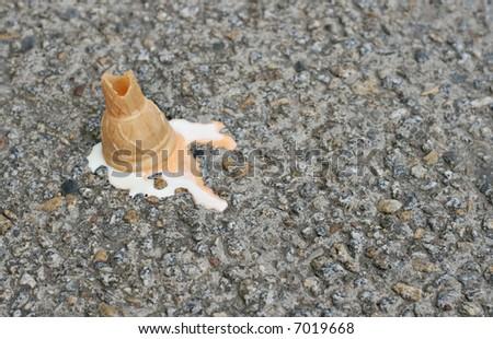 Ice cream fallen on the street - stock photo