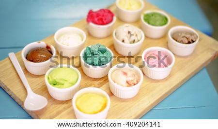 ice cream gelato  scoops on wooden table - stock photo
