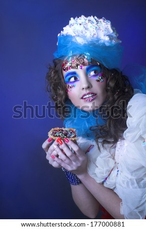 Ice cream girl. Portrait of young woman in creative image.