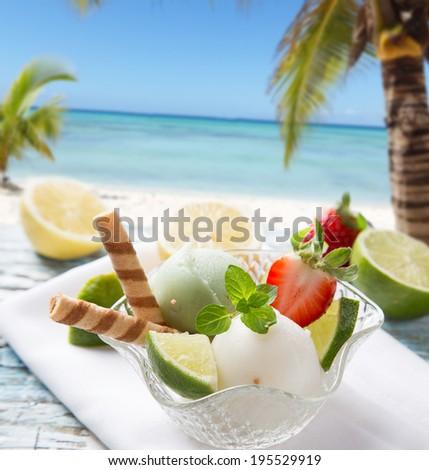 Ice Cream lime, summer sundae with fresh fruits on wooden background. - stock photo
