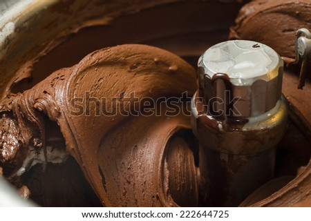 Ice cream preparation with different tools, ingredients, and machines - stock photo