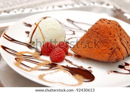 Ice cream, raspberry and chocolate on white plate - stock photo