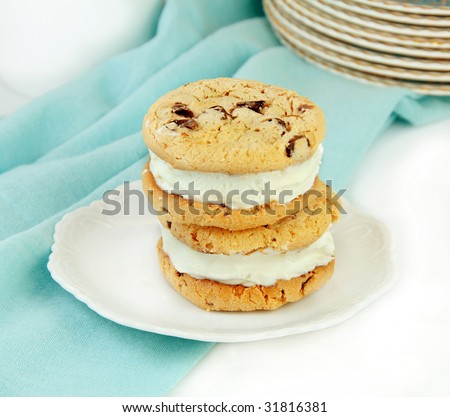 Ice cream sandwiches on a blue and white background. - stock photo