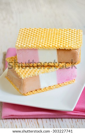 ice cream sandwiches with vanilla, chocolate and strawberry flavors - stock photo