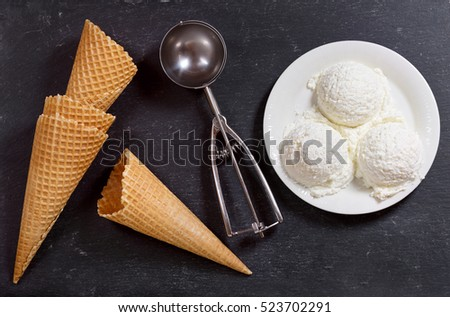 ice cream scoops on dark background, top view