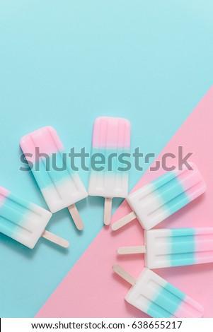 Ice cream sticks on pastel colors background