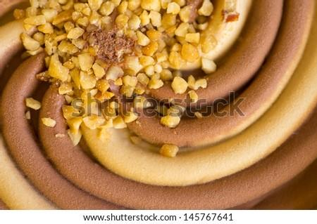 ice cream swirl with nuts close up - stock photo