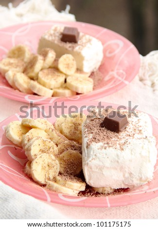 Ice cream with grated chocolate and slices of banana: two portions - stock photo