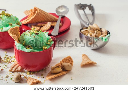 Ice cream with pistachios flavor in the cups,selective focus  - stock photo