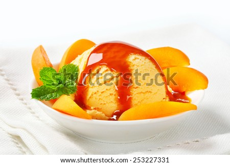 Ice cream with sliced apricot and caramel sauce - stock photo