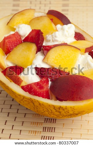 ice cream with strawberries, melon and peach - stock photo