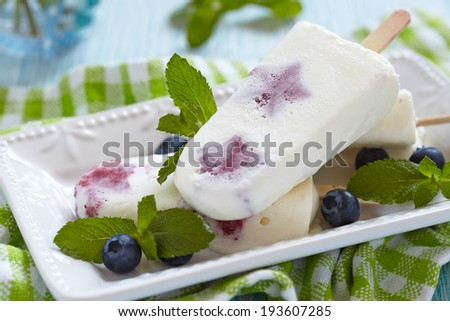 Ice cream with strawberry sorbet and blueberies - stock photo