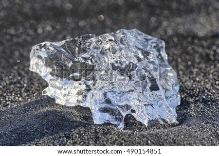 Ice crystal on black lava beach, Iceland