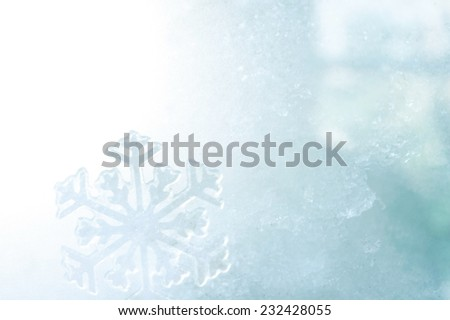 ice crystal on snow in blurred background - stock photo