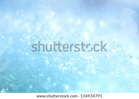 Ice crystals glittering blue background