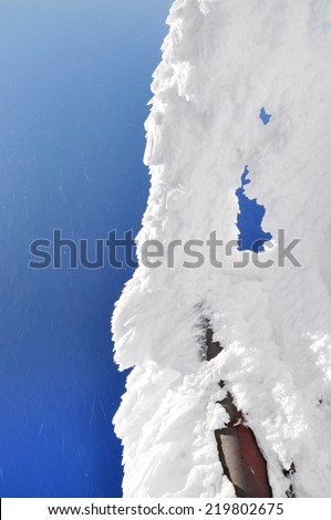 Ice crystals on a frozen house - stock photo