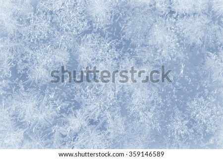 Ice crystals on a glass window during winter. Outside. - stock photo