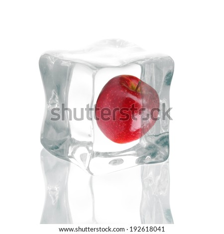 Ice cube and apple isolated on white