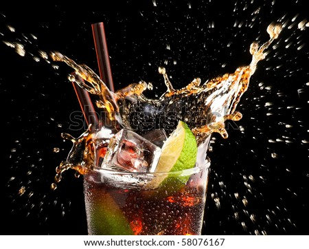 Ice cube and lime splashing cola glass,     Cuba Libre, black backround, close up - stock photo