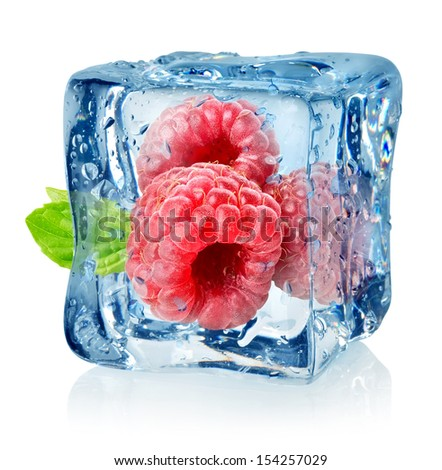 Ice cube and raspberries isolated on a white background