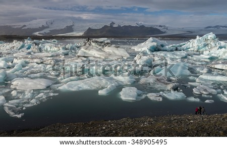 Ice cube at Jokulsarlon glacial lagoon with snow mountain background