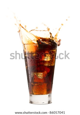 Ice cube droped in cola glass and cola splashing - stock photo