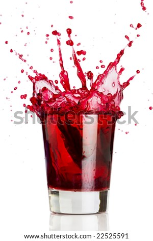 Ice cube dropped into a glass of grape juice - stock photo