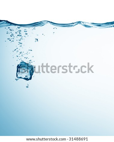 ice cube falling into water with bubbles