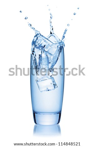 Ice cube splashing into a glass of water, isolated on the white background, clipping path included. - stock photo