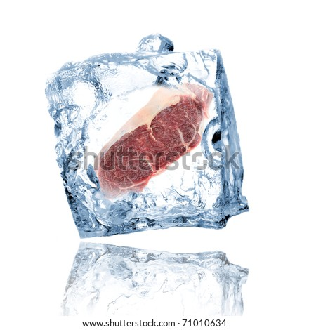 Ice cube with meat isolated on white - stock photo