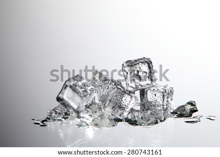 ice cube with water drop on the white background - stock photo