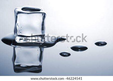 ice cube with water drops - stock photo