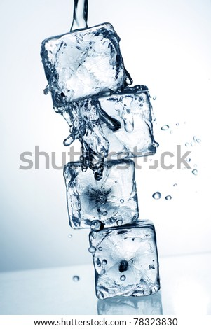 ice cubes and flowing water, with blue toning applied for effect.
