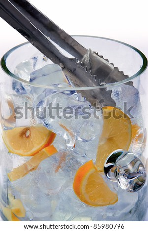 Ice cubes and lemon in a glass bowl - stock photo