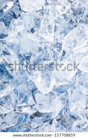 Ice cubes. Blue background - stock photo