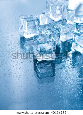 Ice cubes in blue ambient light. Good for background - stock photo
